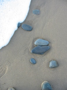 pebbles on a beach, tide coming in